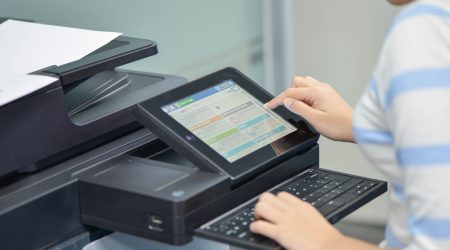 Business Woman Using Cloud-Based App on Photocopier