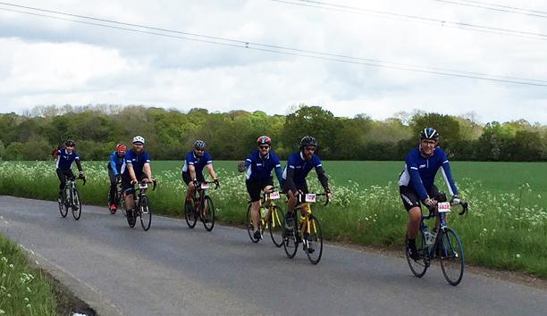 EBM Cycling Team Riding Along Road