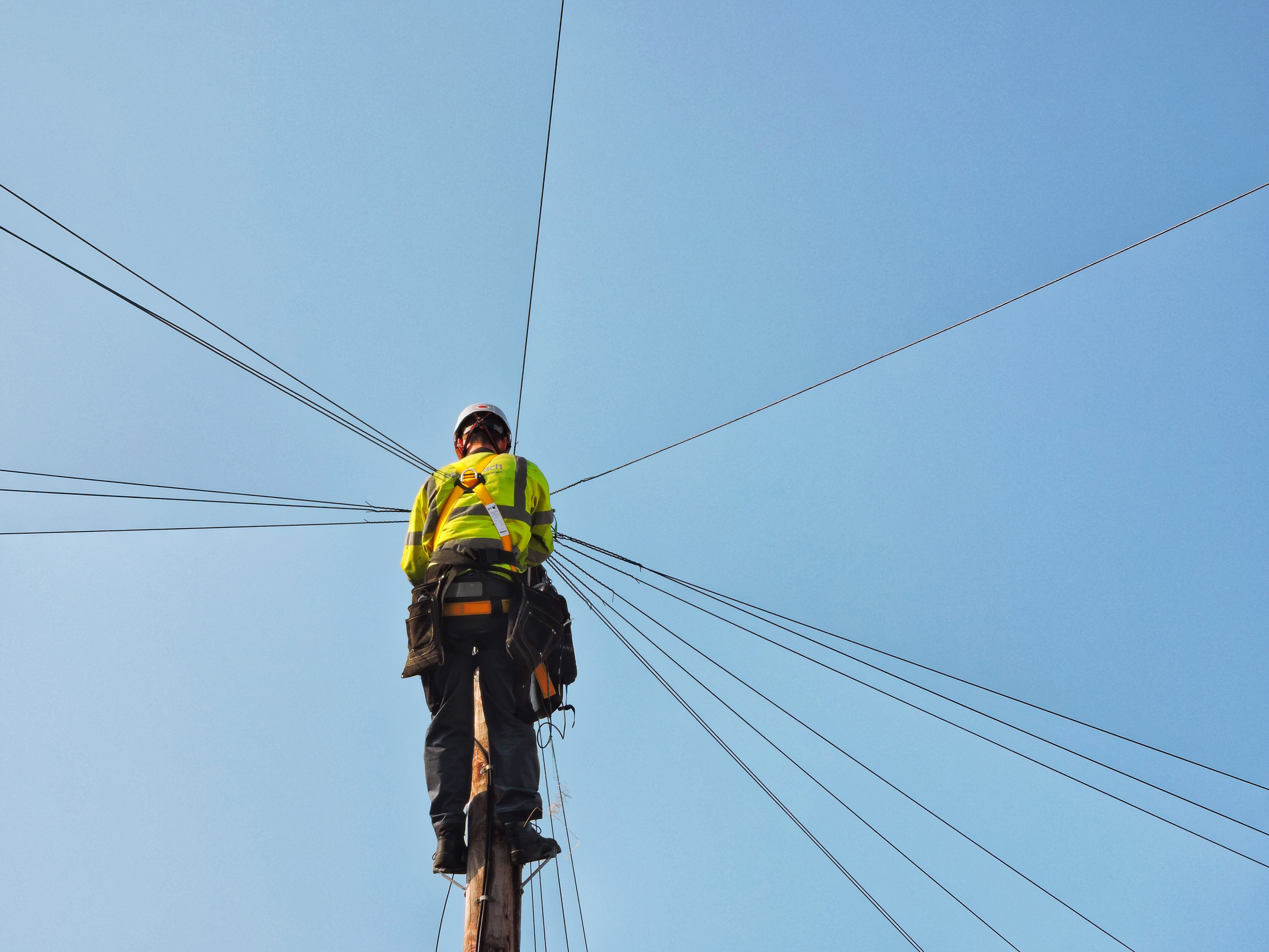 Phone Network - Telecoms Engineer working on Telegraph Pole